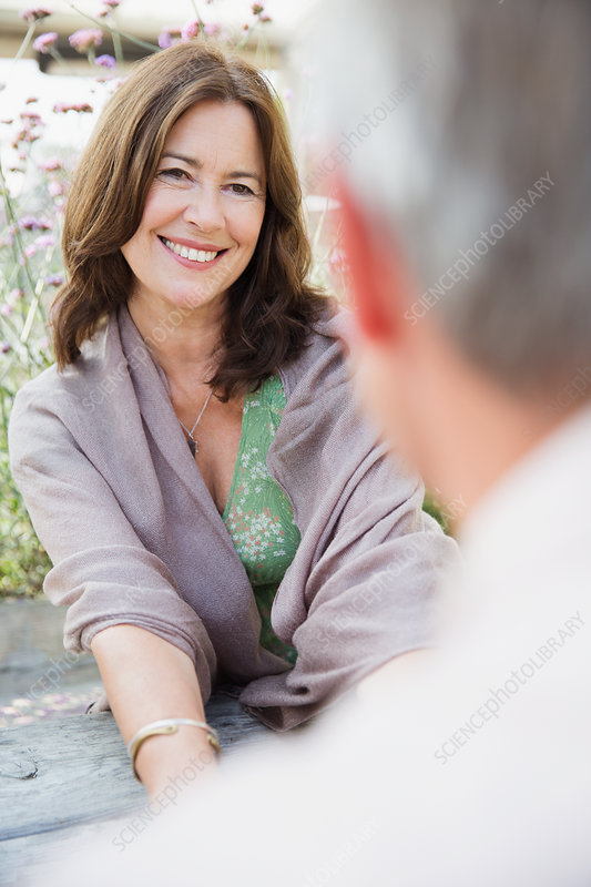 Mature woman smiling at man