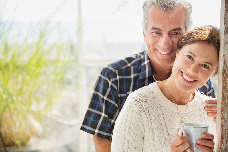 Portrait mature couple drinking coffee