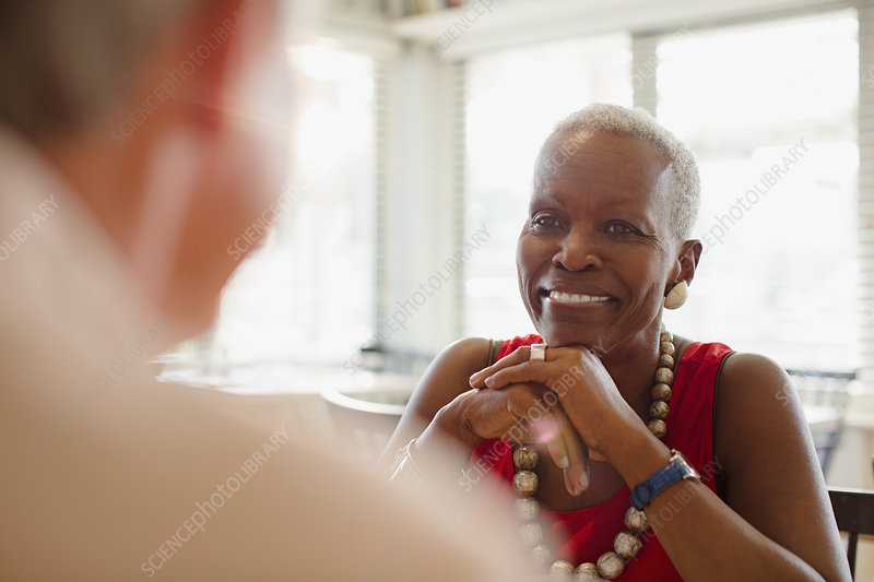 Smiling senior woman dining