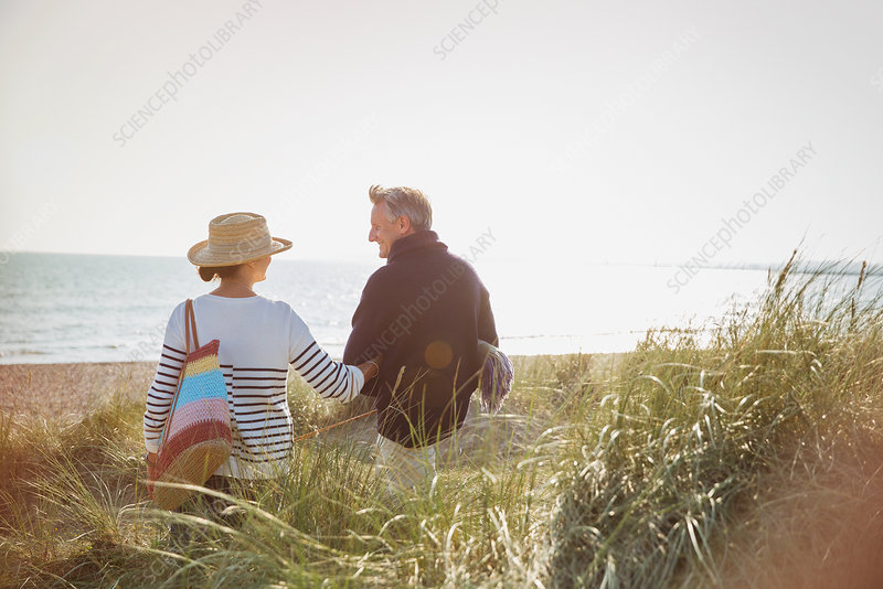 Mature couple walking arm in arm