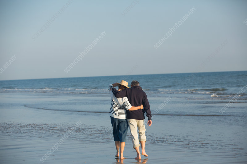Affectionate mature couple hugging, walking