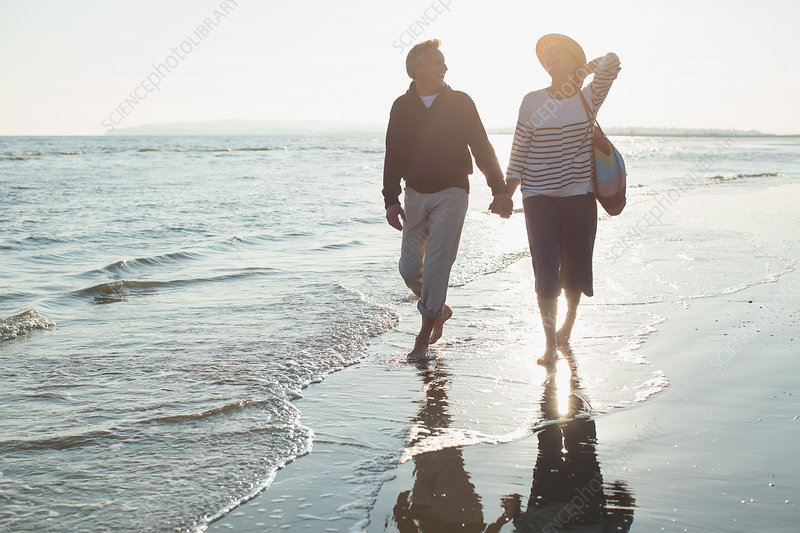 Mature couple holding hands and walking