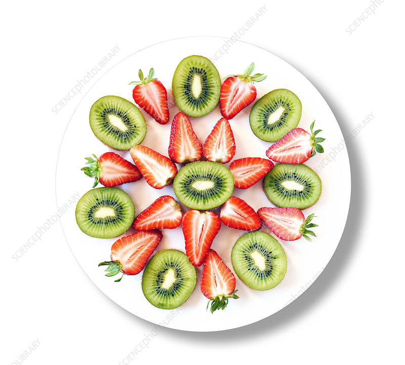 Kiwis and strawberries on white plate