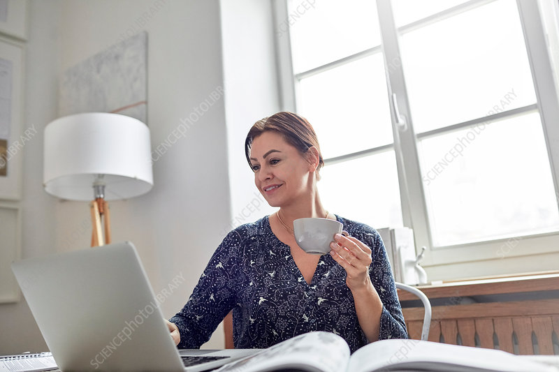 Businesswoman working at laptop