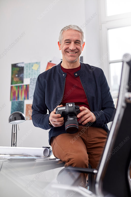 Portrait, male photographer with digital camera