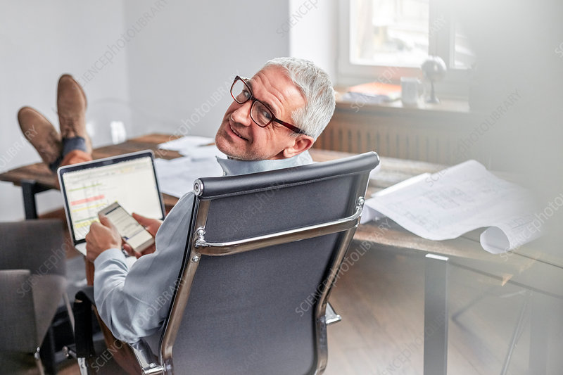 Portrait, businessman with cell phone and laptop