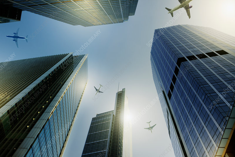Airplanes flying over highrise buildings