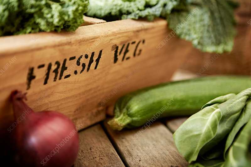 Fresh vegetables and wooden crate