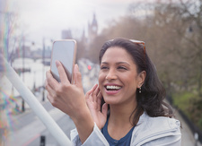 Smiling, woman taking selfie with camera phone