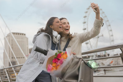 Women friends taking selfie, London, UK