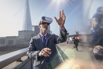 Businessman using VR glasses, London, UK