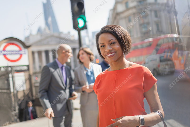 Businesswoman on urban street, London, UK