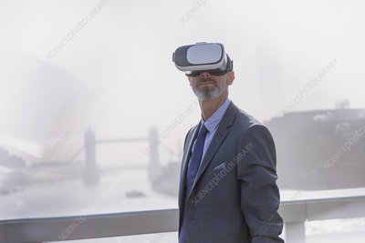 Businessman using VR simulator glasses, London, UK