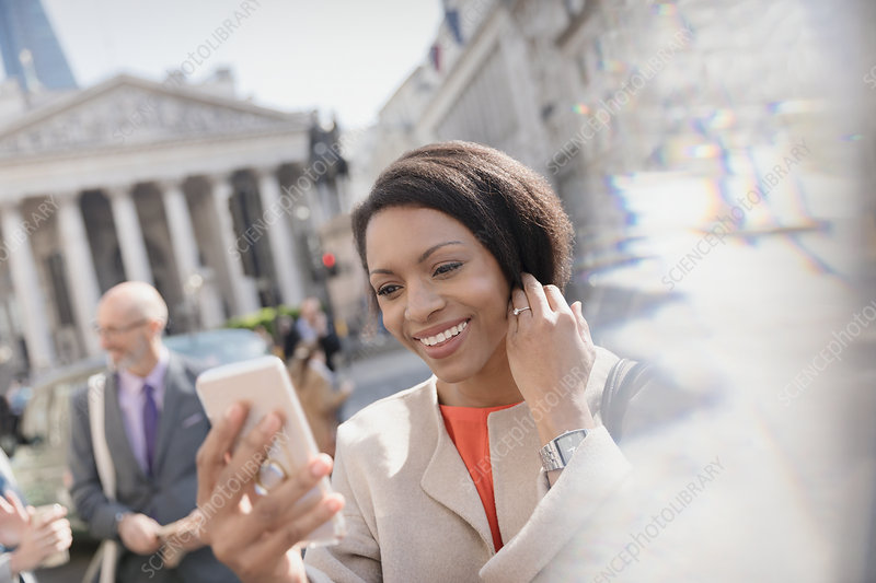 Businesswoman taking selfie, London, UK