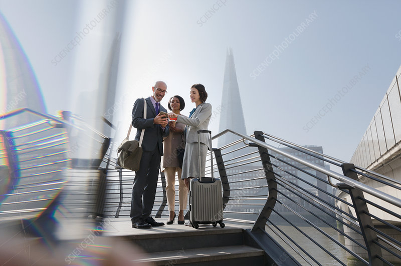 Business people with suitcase, London, UK