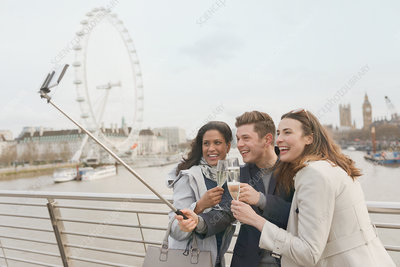 Tourists toasting champagne, London, UK