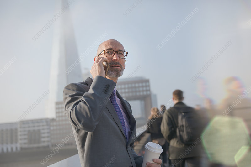 Businessman talking on cell phone, London, UK