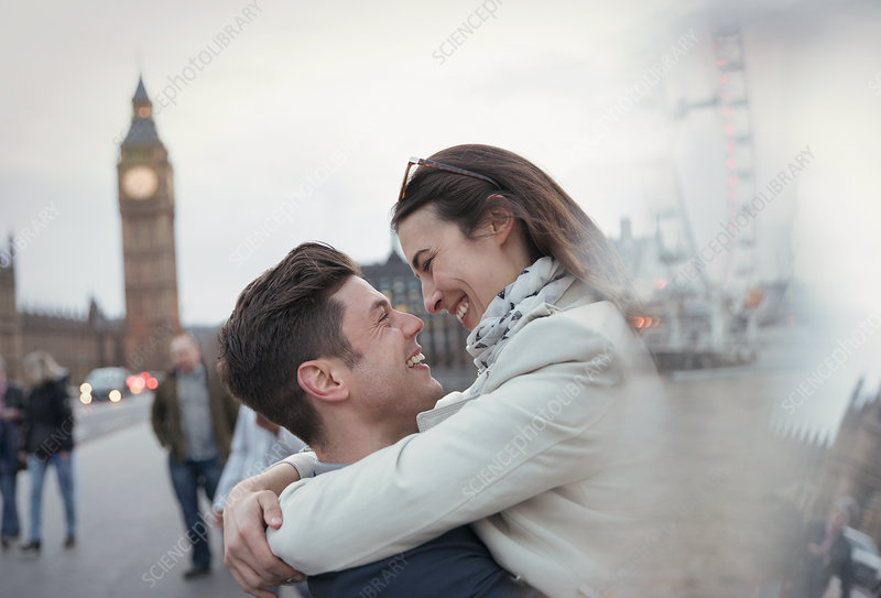 Tourists hugging near Big Ben, London, UK
