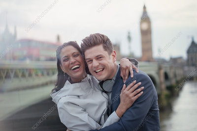 Couple standing at Westminster Bridge, London, UK