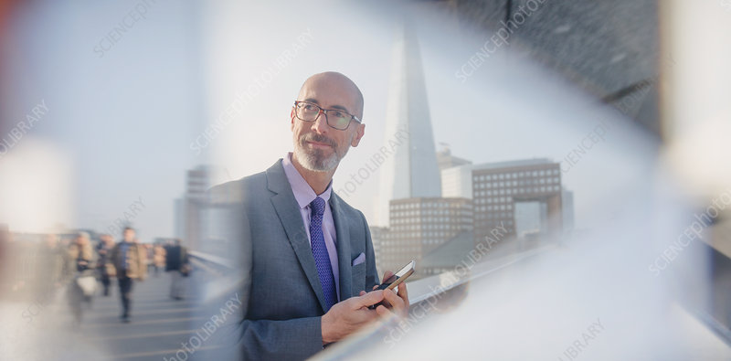 Pensive businessman with tablet, London, UK
