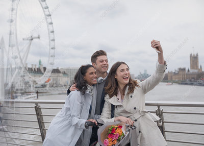 Friends taking selfie, London, UK