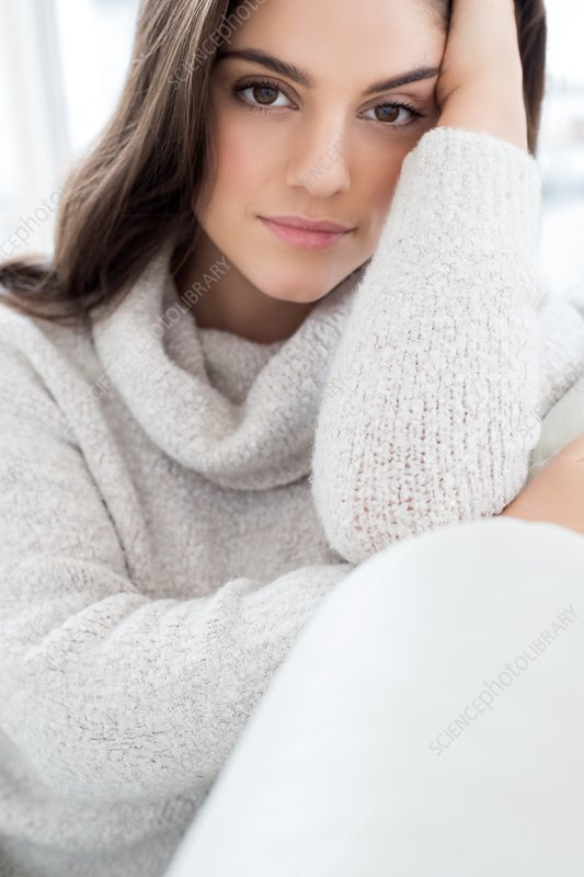 Woman wearing knitted sweater