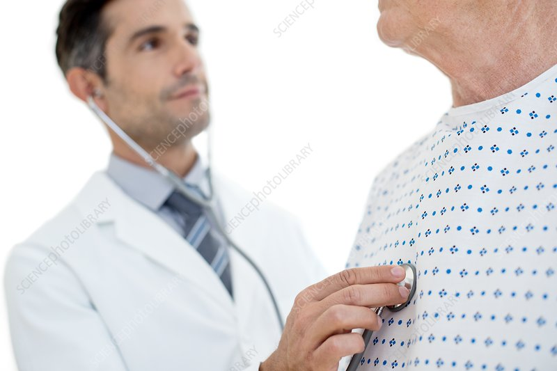 Male doctor examining patient