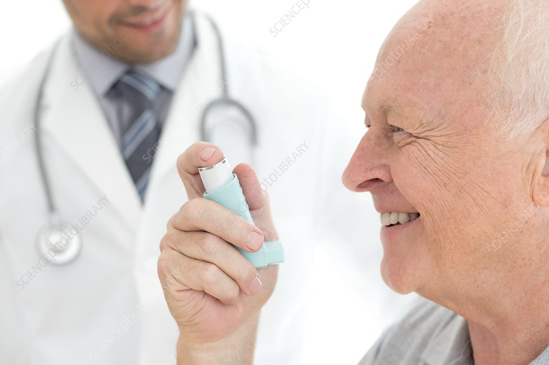 Senior man holding inhaler