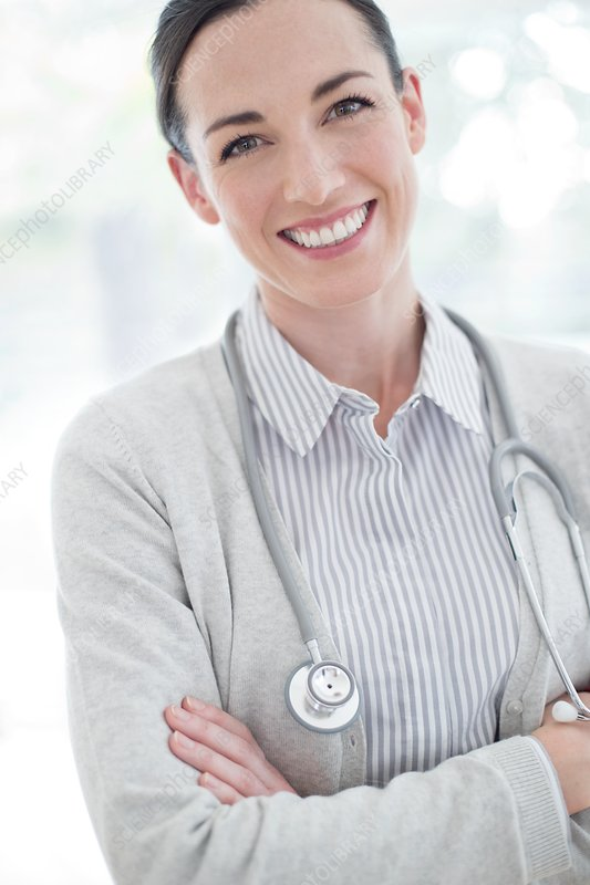 Female doctor with arms folded
