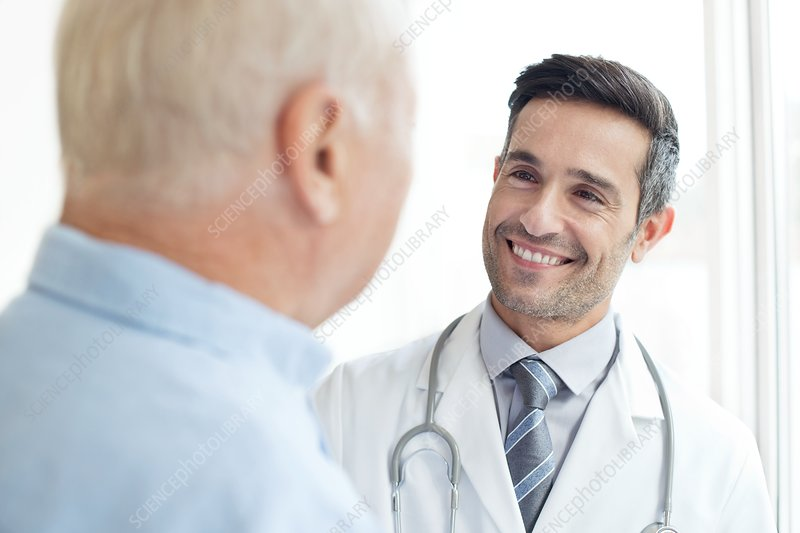 Male doctor smiling at patient