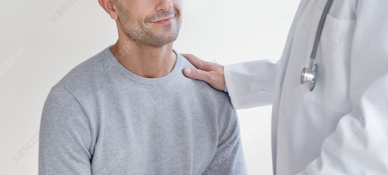 Male doctor with hand on patient's shoulder