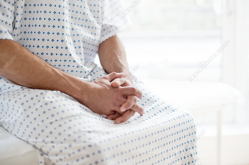 Male patient wearing hospital gown