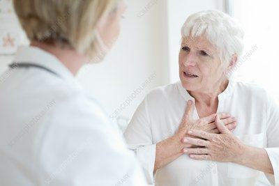 Senior talking to female doctor