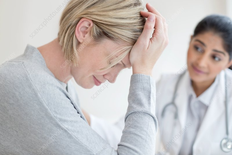 Female doctor listening to patient
