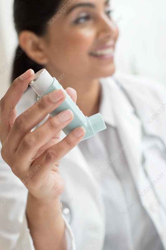 Female doctor holding inhaler