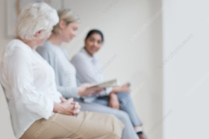 Women sitting in doctor's waiting room