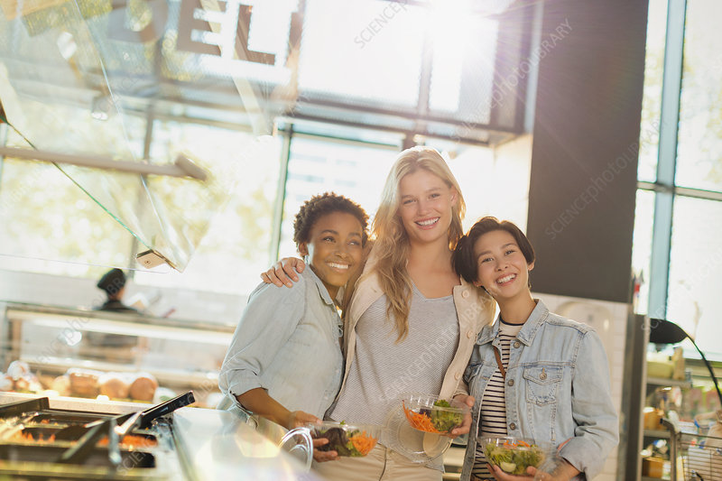 Portrait women enjoying salad bar at market