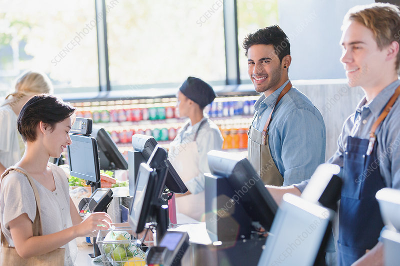 Portrait smiling, confident male cashier