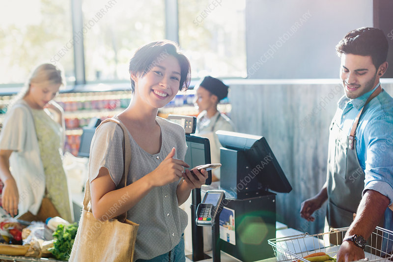 Portrait woman at grocery store checkout