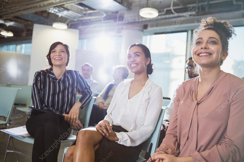 Smiling businesswomen listening