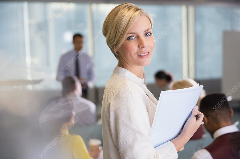 Portrait businesswoman with paperwork