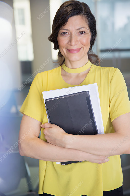 Portrait businesswoman with tablet and paperwork