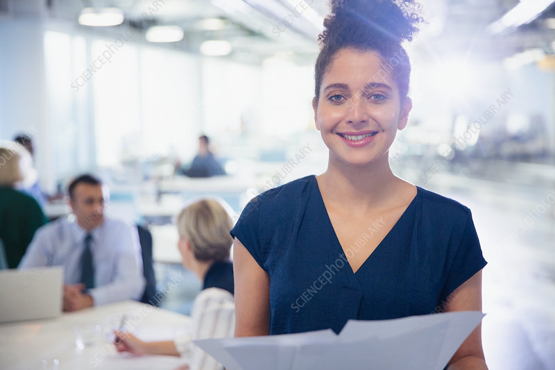 Portrait young businesswoman with paperwork
