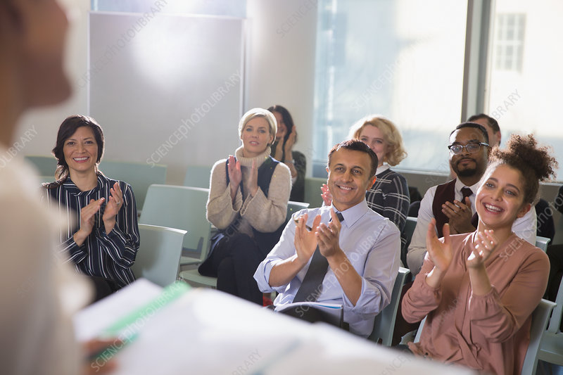 Business people in audience clapping