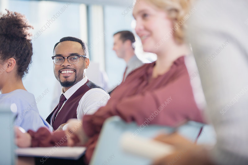 Smiling businessman listening