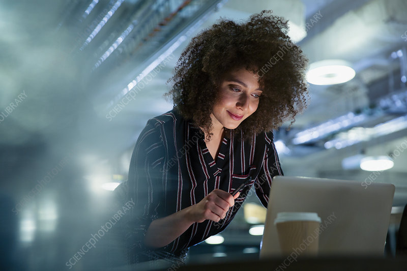 Businesswoman working late at computer in office
