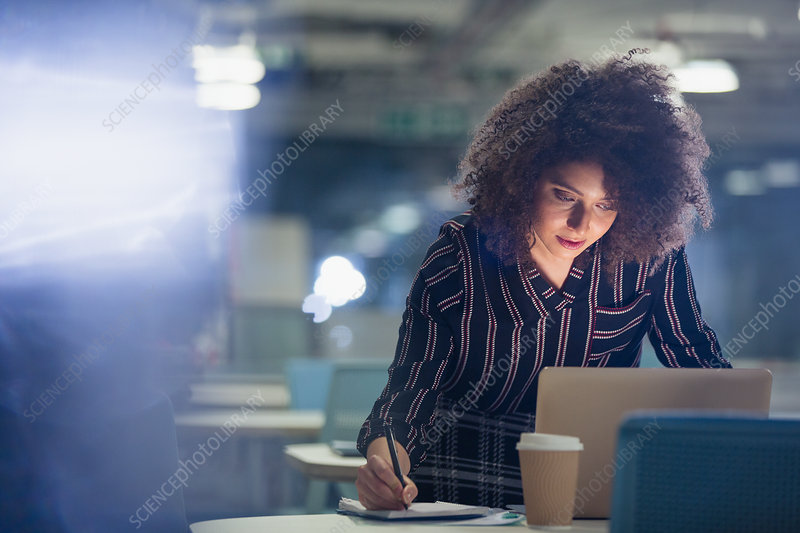 Focused businesswoman working late