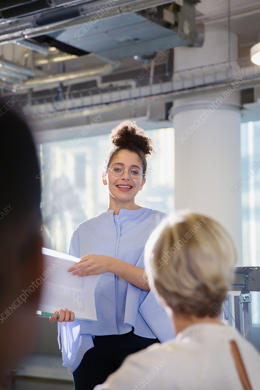 Businesswoman leading conference presentation