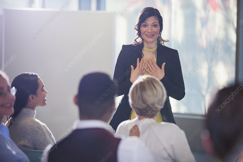 Businesswoman leading conference meeting