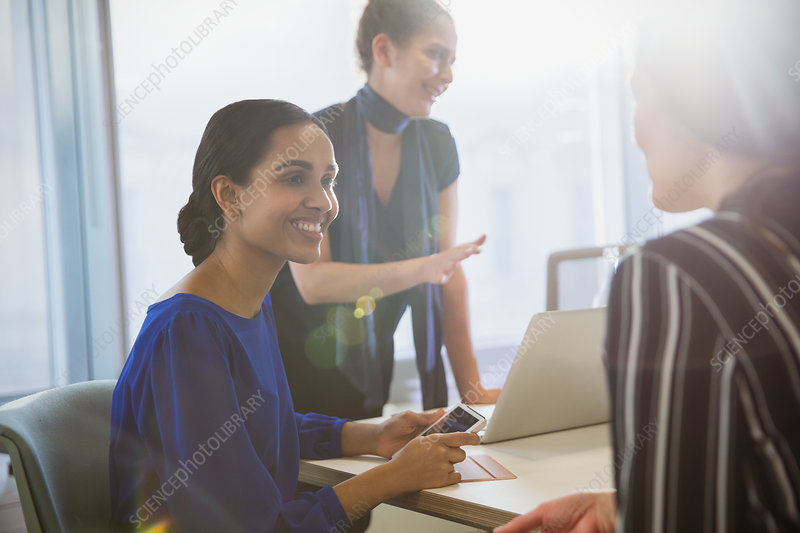 Smiling businesswomen talking